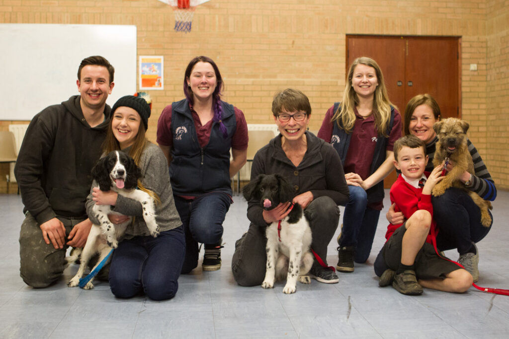 Owners and puppies graduating from Puppy School with their tutors